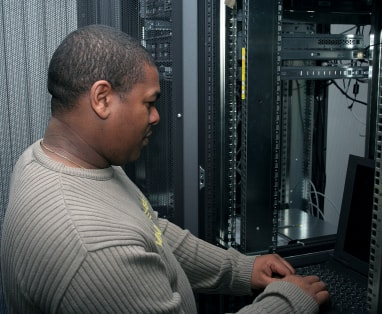 man working in server room image